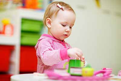 Toddler care in Dublin Ohio - kid playing with blocks